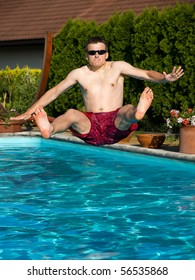 young man is jumping into pool
