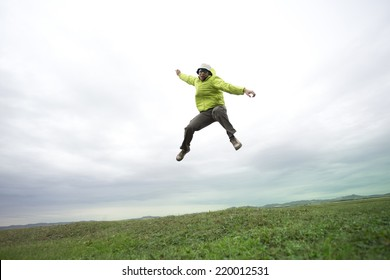 Young man jumping on the grass land