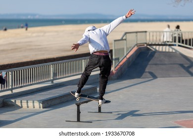 young man jumping on skateboard in skatepark