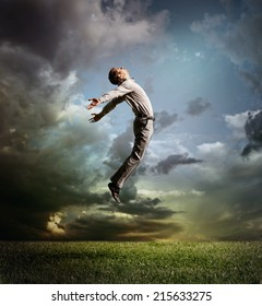 Young man jumping up to Sky