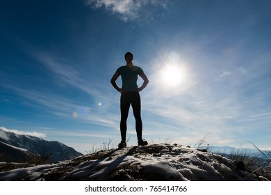 Young man jumps on the mountain