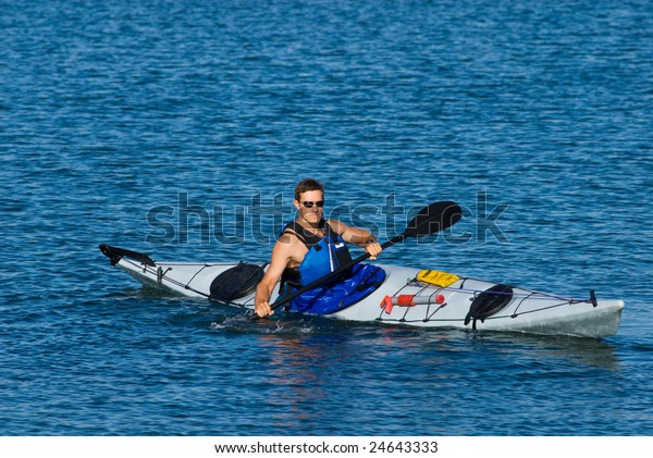 Young Man Kayaking Calm Blue Waters Stock Photo Edit Now