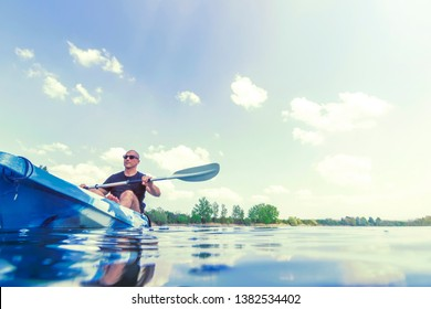 Young Man Kayaking on Lake. Lake Kayaking.