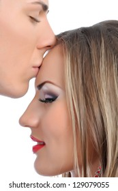 Young man kisses young woman ,couple in love