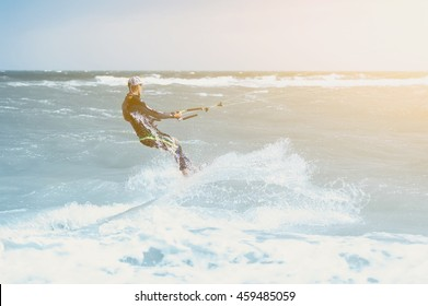 young man kiting in clear blue water. vintage picture