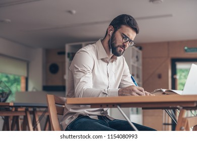 Young man with laptop in coworking