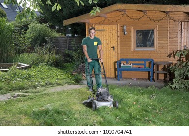 young man with a lawn mower