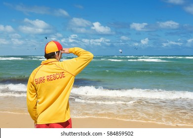 young man  lifesaver  watching the situation on the sea