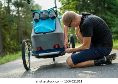 Young man with in line skates fixes broken baby stroller