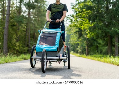 Young man in line skating outdoors with baby stroller