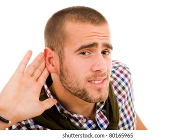 Young man listening the conversation, isolated over white background