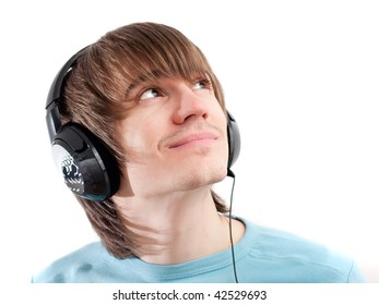 Young man listening to music with headphones. White background