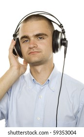 Young man listening music. On a white background