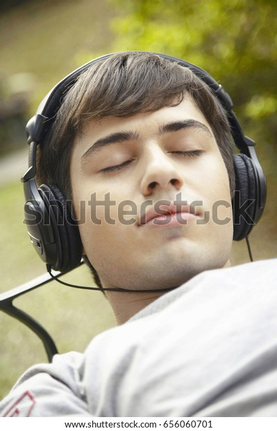 Young Man Listening Music On Headphones Stock Photo (Edit