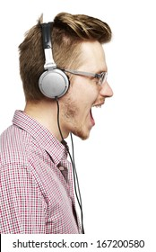 Young man listening to music and singing with headphones. Isolated on white.