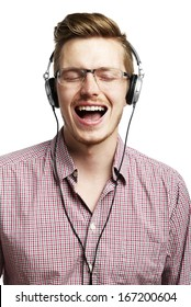 Young man listening to music and singing with headphones. Eyes Closed.