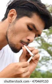 Young man lite cigarette from another cigarette, healthy lifestyle