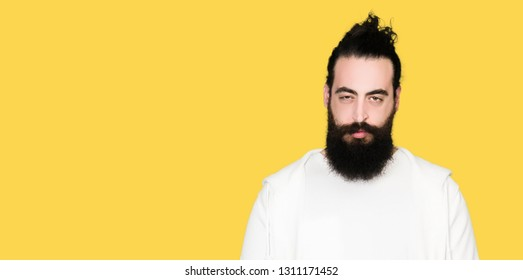 Young man with long hair and beard wearing sporty sweatshirt skeptic and nervous, frowning upset because of problem. Negative person.