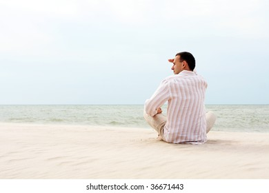 young man looking afar near the sea