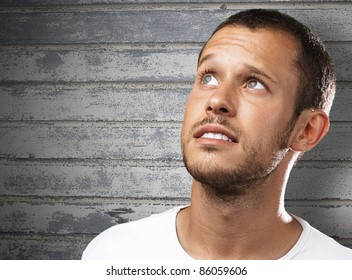 young man looking up against a grunge background