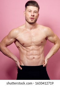 young man looking at the camera with a beautiful body isolated background