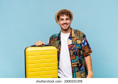 young man looking happy and goofy with a broad, fun, loony smile and eyes wide open. holidays concept