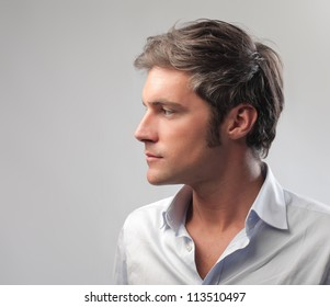 Young man looking at his side