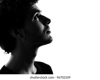 young man looking up portrait silhouette in studio isolated on white background