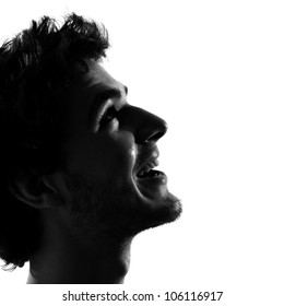 young man looking up smiling happy portrait silhouette in studio isolated on white background