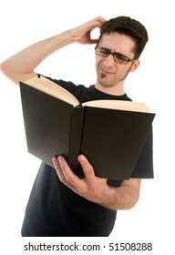 A young man looking unsure of what he is reading.
