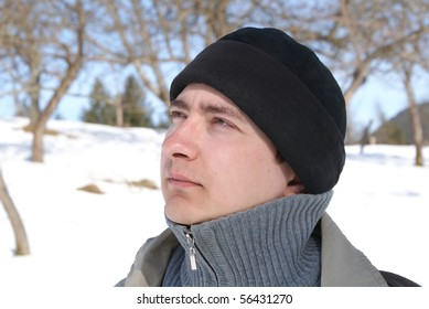 Young man looks into the distance, brooding eyes, directed toward