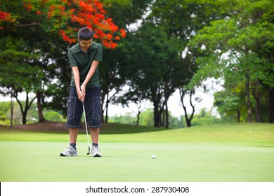 Young man looks on after the putt he has just made
