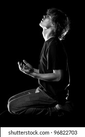Young man looks up in prayer