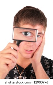 young man looks through magnifier