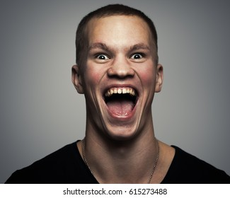 young man with a loud and scary scream. Portrait