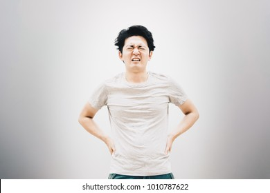 Young man with low back pain