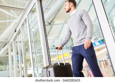 Young man with luggage in the airport terminal on arrival or when transferring