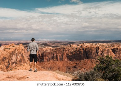 young man with Magnificent view of Grand Canyon, Arizona, USA