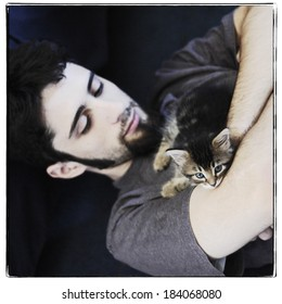 Young man with maine coon kitten, instagram style