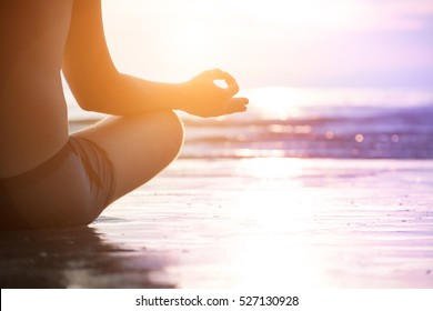 Young man make meditation in lotus pose, yoga and wellness concept.