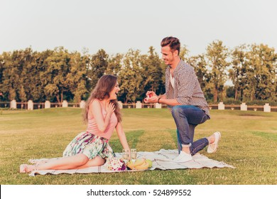 young man makes a proposal of betrothal to his girlfriend.
