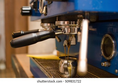 Young man making coffee in the cafe