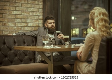Young man making an exasperated expression gesture on a bad date at the restaurant.