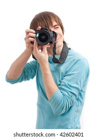 Young man making photo with professional camera.  Front view. Over white