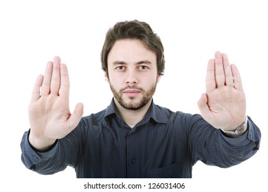 young man making stop with his hands, isolated