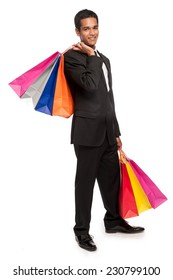 Young man with many colorful shopping bags.