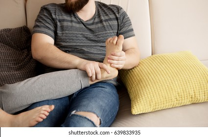 Young man massaging his lover's feet.