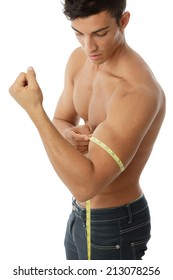 Young man measuring his biceps.