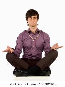 Young man meditating.