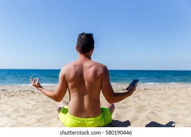 Young man meditating sitting back